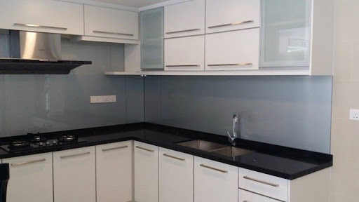Black countertop and white kitchen cabinet